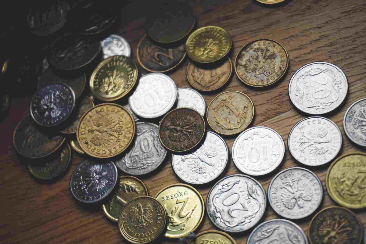 gambar uang kartal berbentuk koin